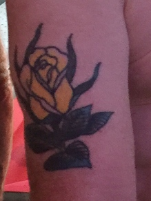 Richard, a gardener, showed off a yellow rose tattoo in memory of his late mother's favorite flower.